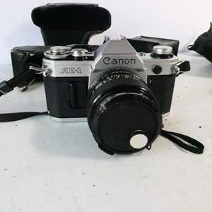"Auction Thumbnail for: Lot # 8- Canon Camera with accessories. ""AE-1""  with Sony lens"