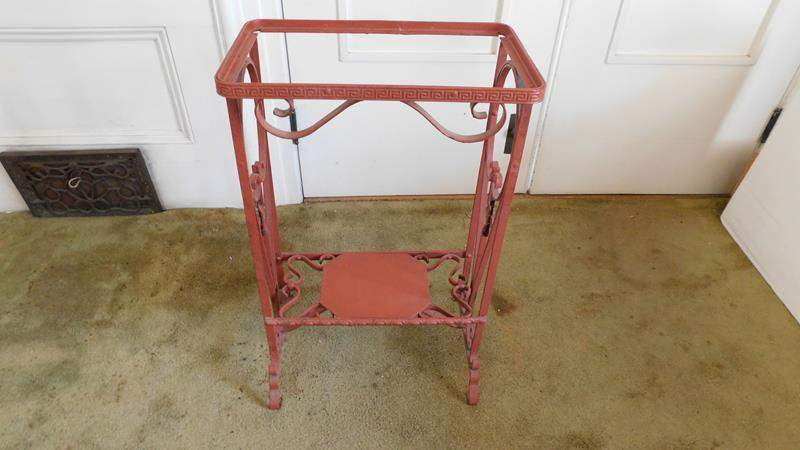 Lot # 17- Antique Red Iron Table Stand   Vintage table cloth (main image)