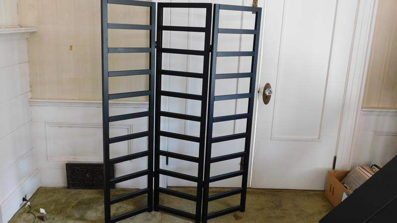 Lot # 29- Four black accordion room dividers (main image)