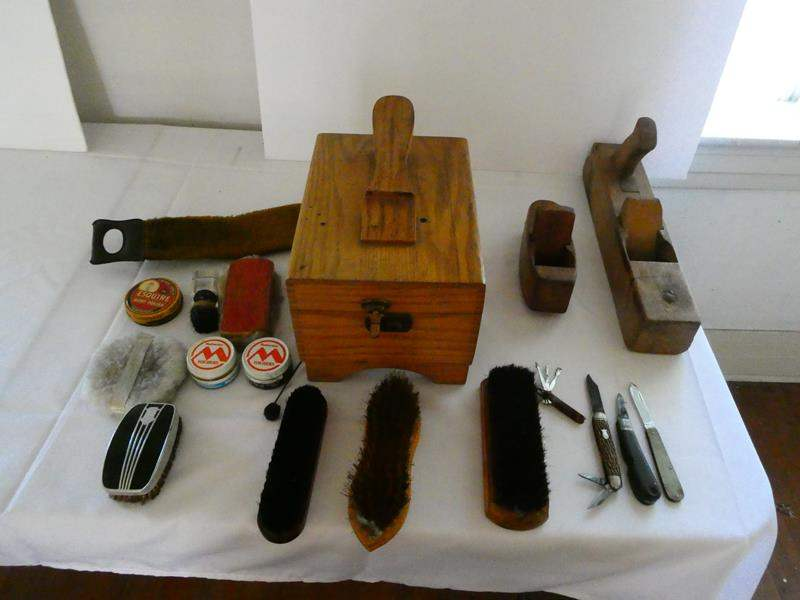 Lot # 118- Antique wooden planes, pocket knives, and shoe shine kit (main image)