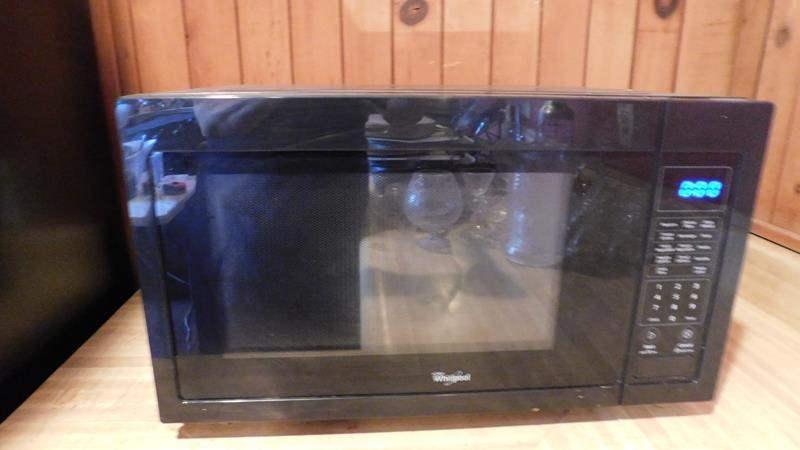 Lot # 78- Black Whirlpool Microwave (main image)