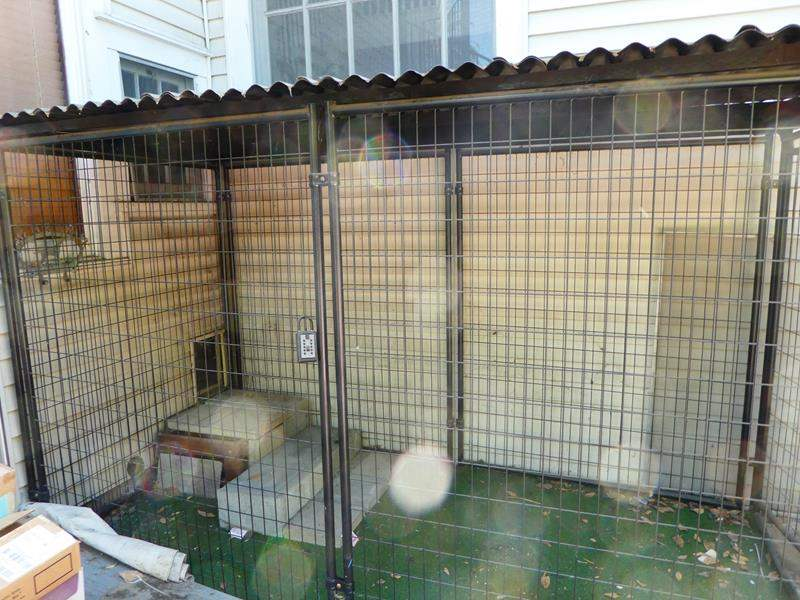 Lot # 405-  Extra large sturdy covered dog kennel (main image)
