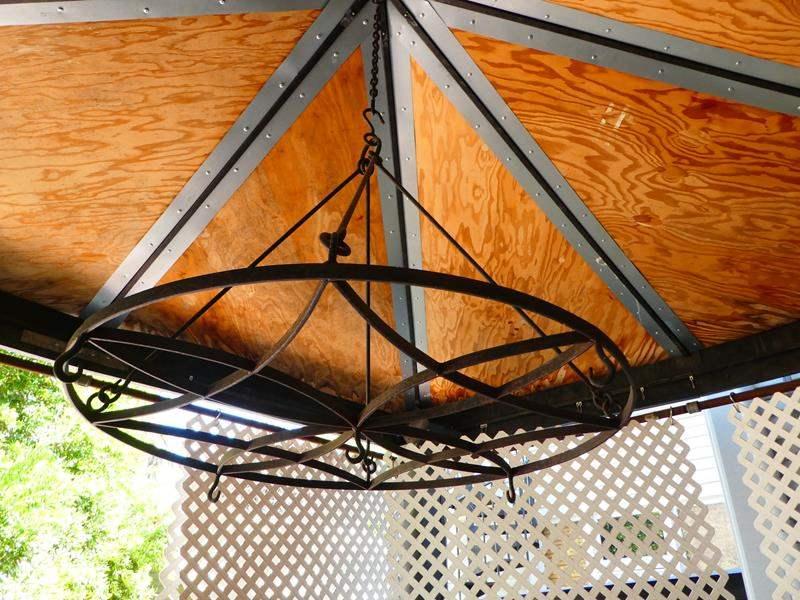 Lot # 413- Iron decorative (chandelier style) hanger (main image)