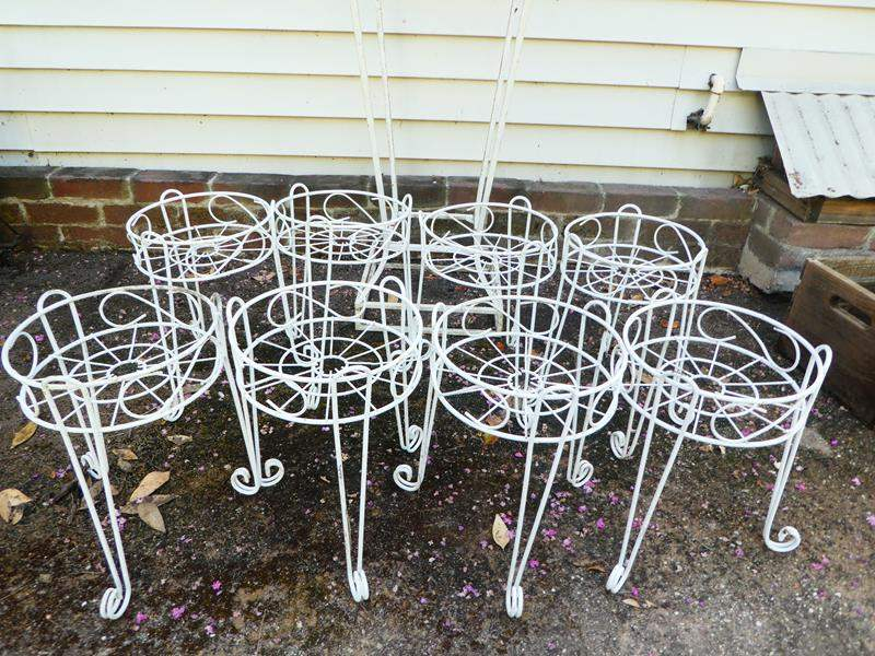 Lot # 415- 8 white decorative iron plant holders and large stand (main image)