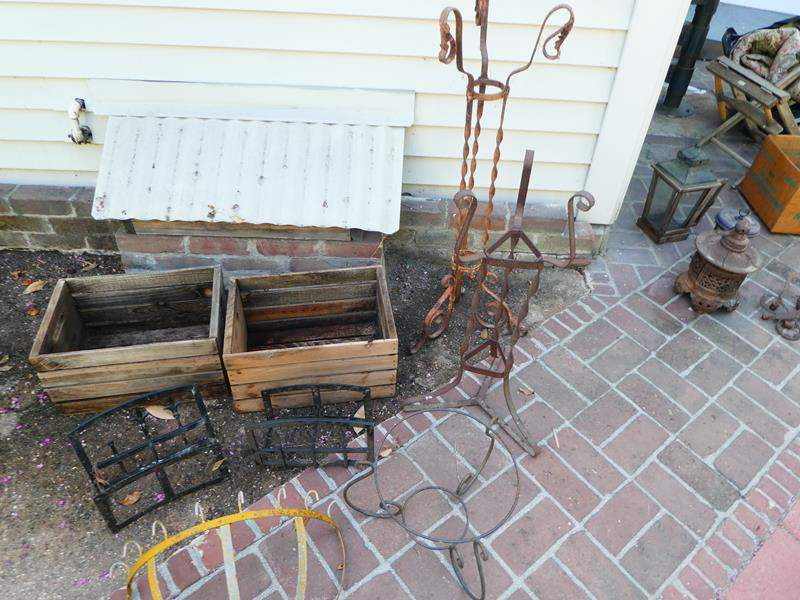 Lot # 416- 2 Wooden box crates and iron/metal yard décor (main image)