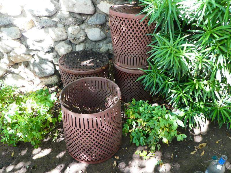 Lot # 421- 4 Metal baskets/ planters and 3 iron plant stands (main image)
