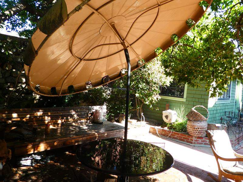 Lot # 424- Metal table and umbrella (main image)