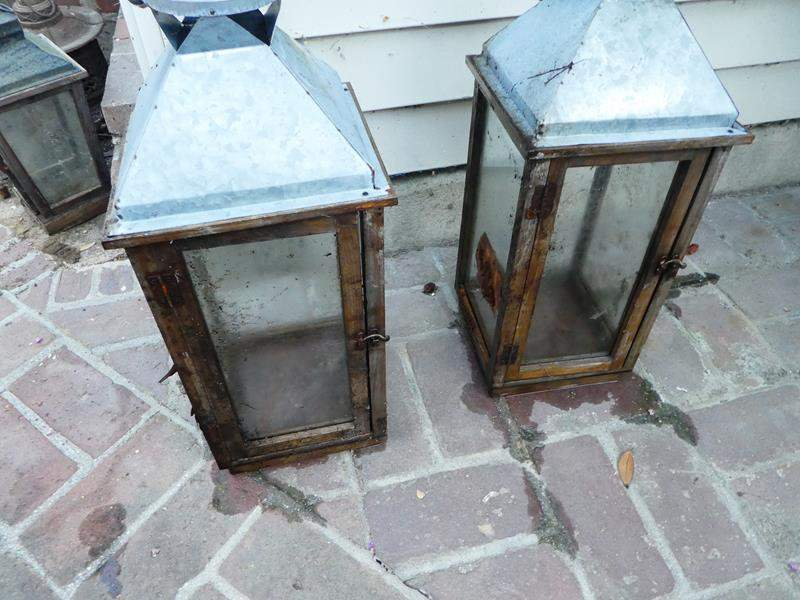 Lot # 447- Two large decorative, rustic outdoor lanterns (main image)