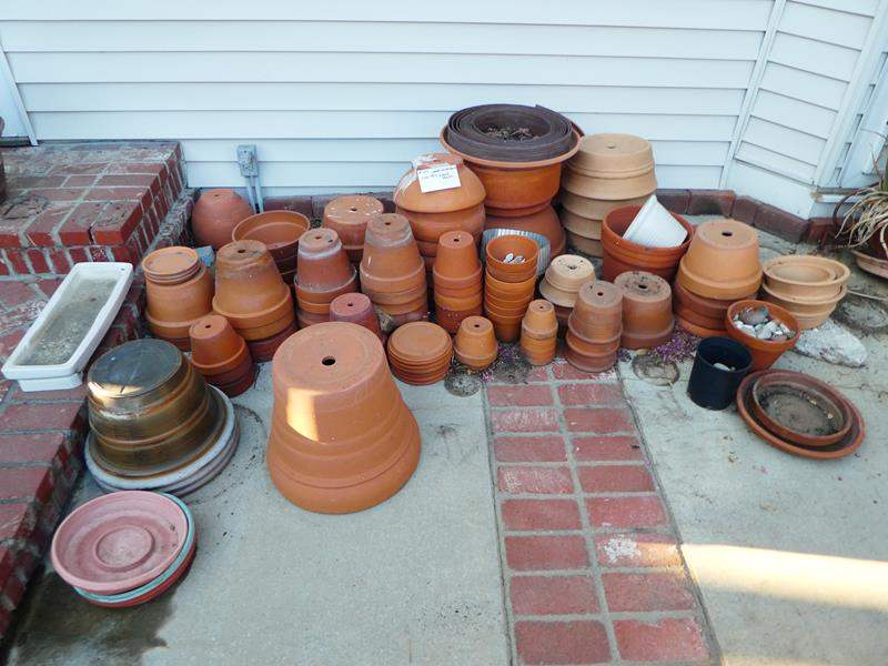 Lot # 454- Large collection of clay pots and some plastic pots (main image)