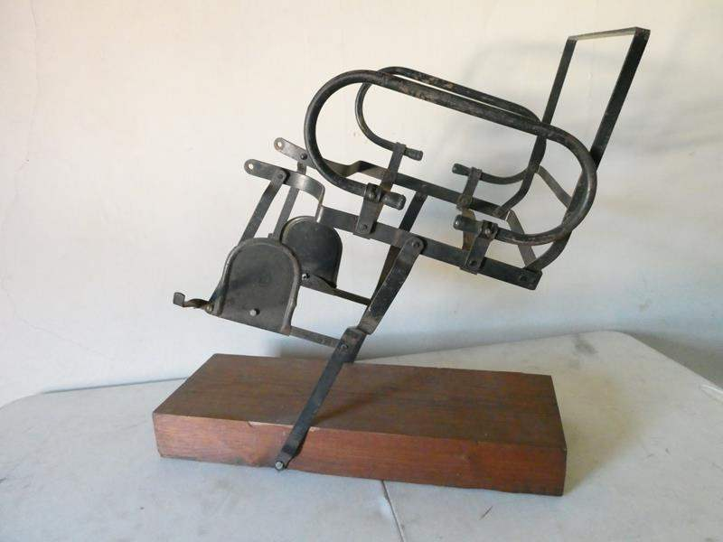 "Lot # 181-Vintage/ antique child's rear metal bike seat. (no cushion) mounted on block of wood. 25"" tall (main image)"
