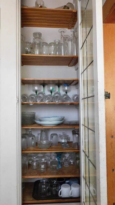 Lot # 76- An entire cupboard of glassware (main image)