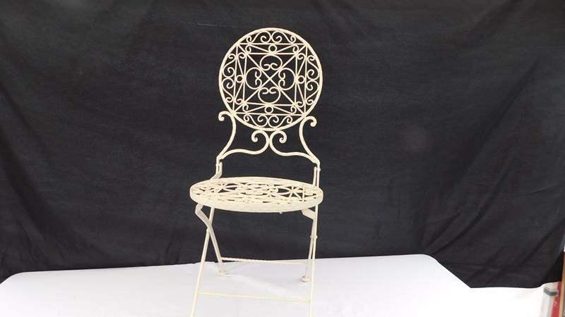 Lot # 28 - White folding metal chair (main image)