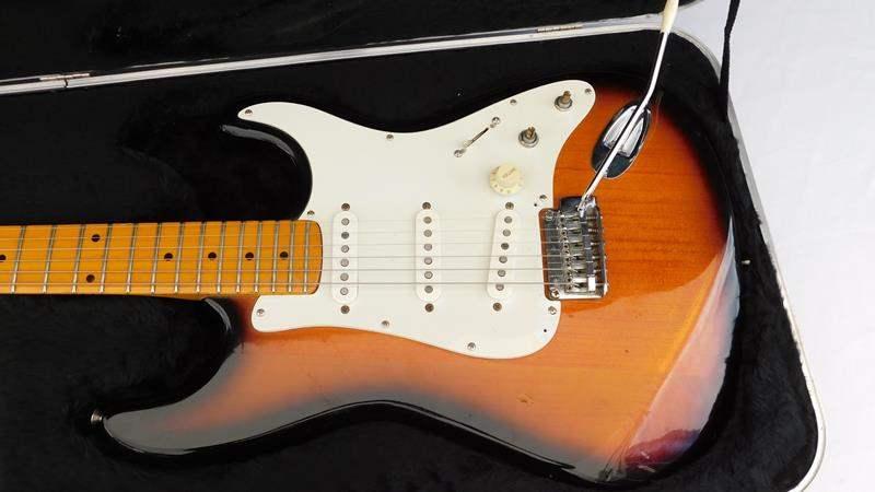 Lot # 30 - Electric Guitar, fender case, vocal training program (main image)
