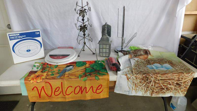 Lot # 95 - Fun lot!  House flags | heater | toilet seat | wine rack and more (main image)