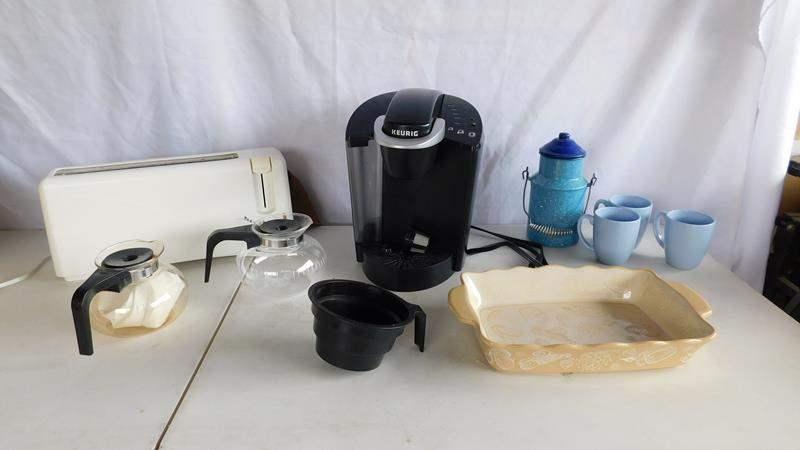 Lot # 99 - Keurig coffee maker | Bread man | mugs | dish | coffee pot (main image)