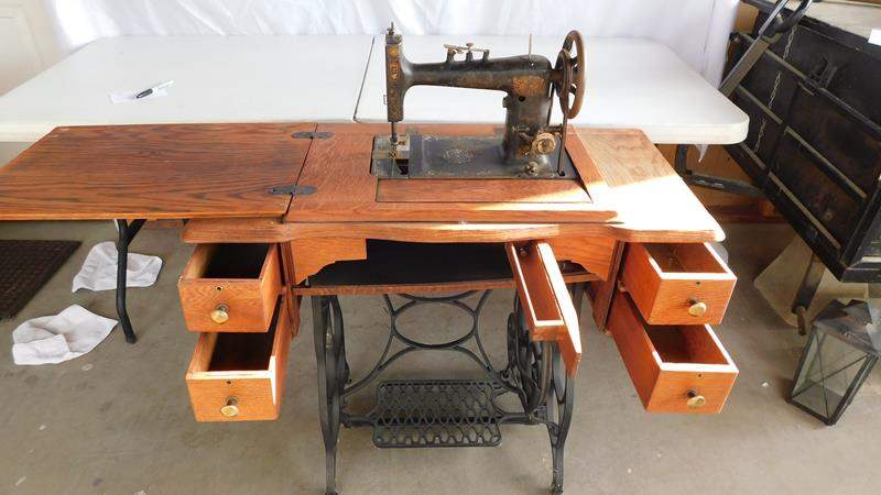 Lot # 103 - Antique sewing machine in sewing stand/ table (main image)