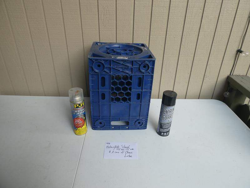 Lot # 406- Motorcycle stand and 2 cans of chain lube (main image)