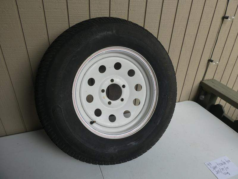 Lot # 409-Spare trailer tire 205/75/15- 5 LUG (main image)