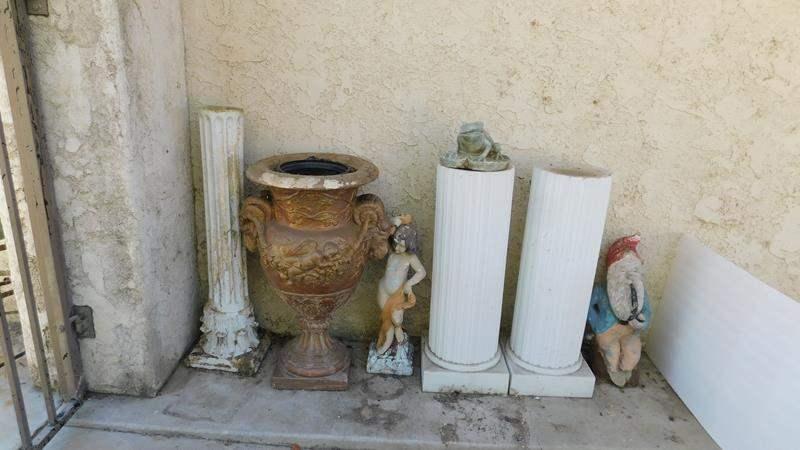 Lot # 393- Yard Art, pillars and pots (main image)