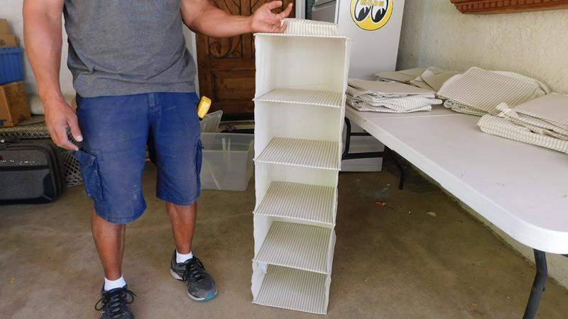 Lot # 398- Hanging shelf / shoe rack- 7 or 8  total (main image)