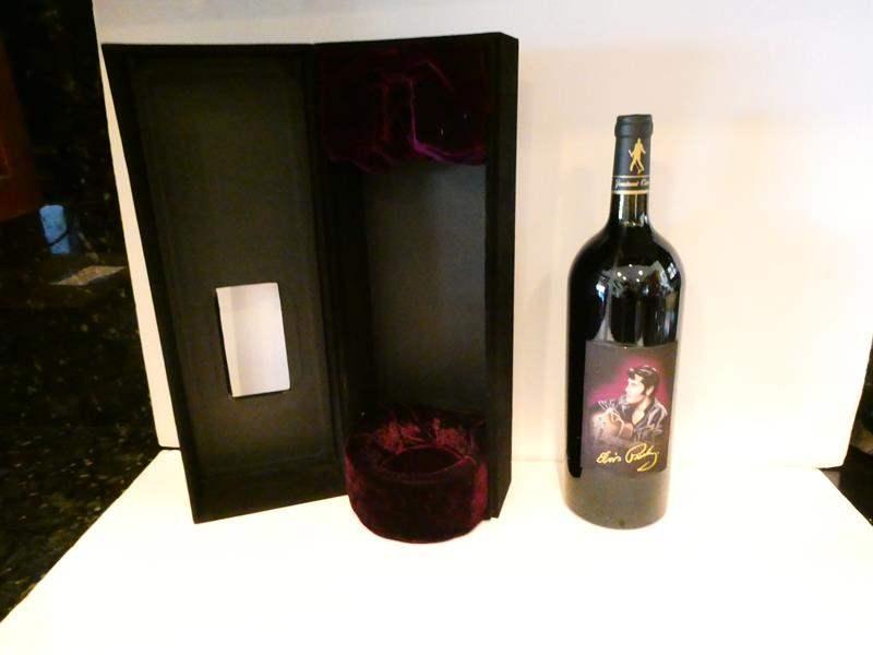 Lot # 14- Elvis collectible sealed bottle (main image)