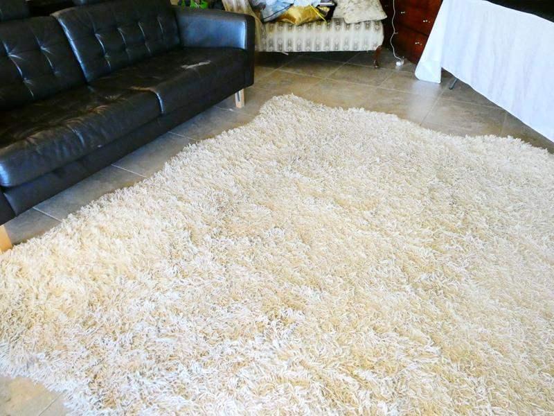 Lot # 29- Stylish cream shag rug (main image)