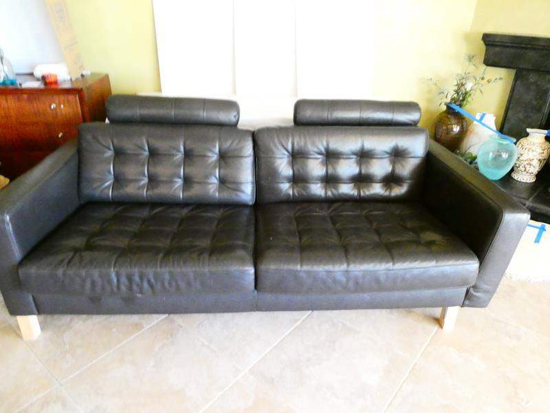 Lot # 30- black leather couch & ottoman (main image)