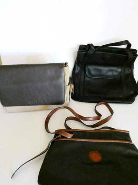 Lot # 33- Three leather purses gently used (main image)