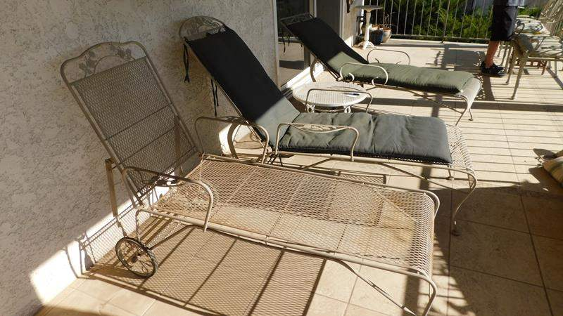 Lot # 503-3 Russel Woodward, Steel reclining lounge chairs on wheels, 1 round steel table (main image)