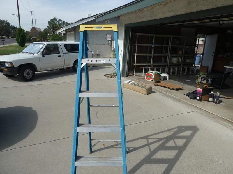 Lot # 203- Werner Fiber glass 6ft. step ladder and plastic step stool (main image)