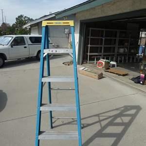 Lot # 203- Werner Fiber glass 6ft. step ladder and plastic step stool