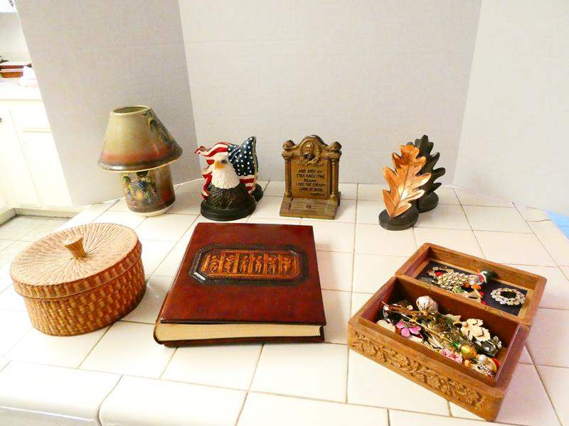 Lot # 59- Unique decor | Cast Iron Bookends, carved wooden box full of treasures, and much more (main image)