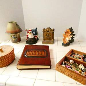 Lot # 59- Unique decor | Cast Iron Bookends, carved wooden box full of treasures, and much more
