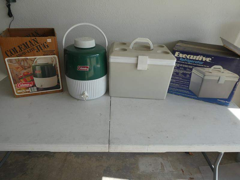 Lot # 209- Coleman Snow-lite, Jug 2 Gallon model and executive refrigerator  (main image)