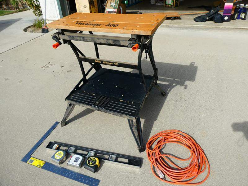 Lot # 212-  8 Piece work bench, measuring tape extension cord, drill bit asortment, & level (main image)