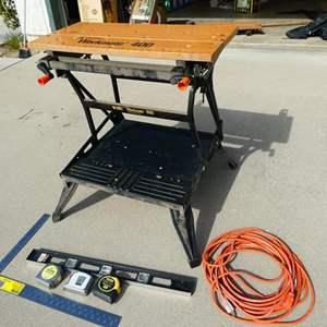 Lot # 212-  8 Piece work bench, measuring tape extension cord, drill bit asortment, & level