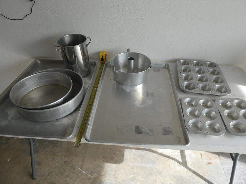 Lot # 213- Master Baker supples: Giant cookie sheets, cake pans, pizza peel boards, & more (main image)