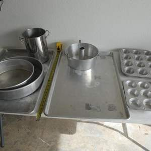 Lot # 213- Master Baker supples: Giant cookie sheets, cake pans, pizza peel boards, & more