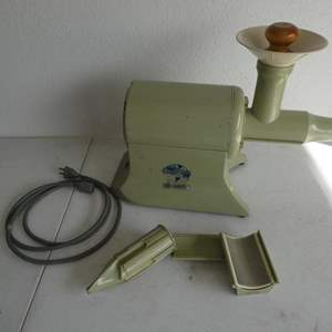 """Lot # 215- Vintage """"The Champion"""" juicer with attachments"""