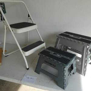 Lot # 217- Three step stools- different sizes- see pics