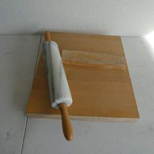 Lot # 218- Marble or granite rolling pin and wood cutting board