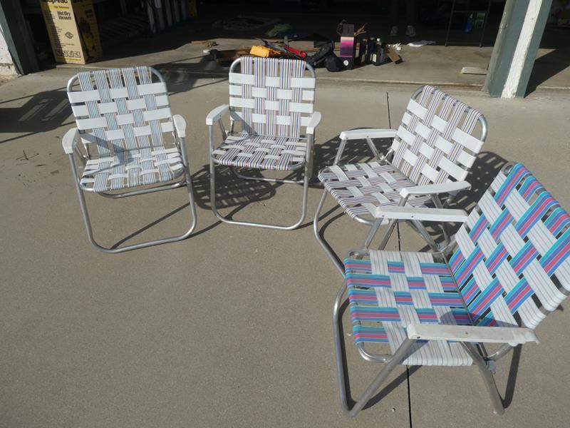 Lot # 223- Four peice foldable lawn chairs. 2 in good shape (main image)