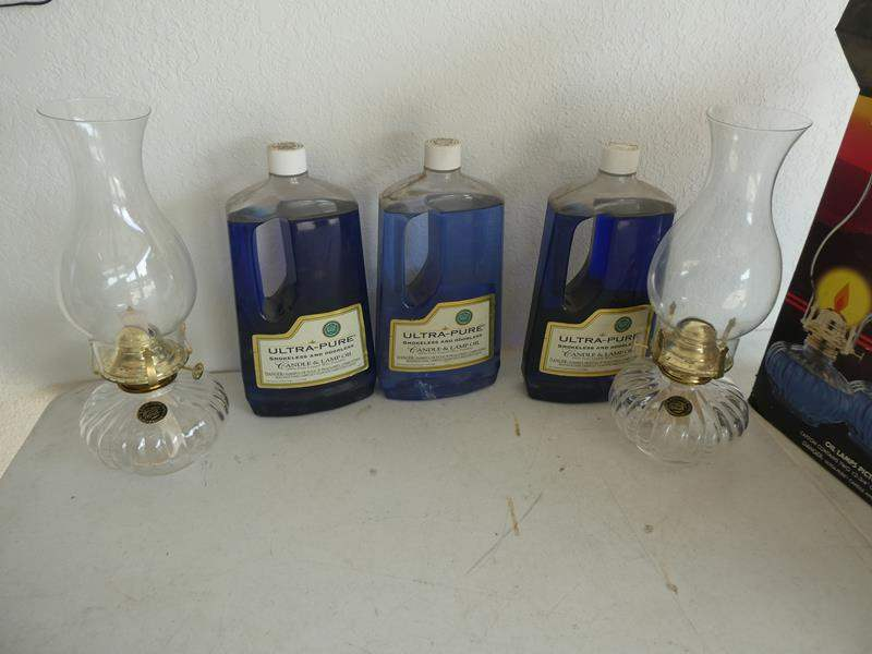 Lot # 225- Two lamp lights and 3 bottles of Lampoil (new) (main image)