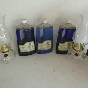 Lot # 225- Two lamp lights and 3 bottles of Lampoil (new)