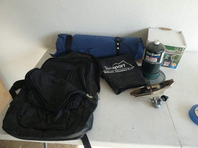 Lot # 226- Coleman Propane stove, backpack, Texsport camping air mattress (main image)
