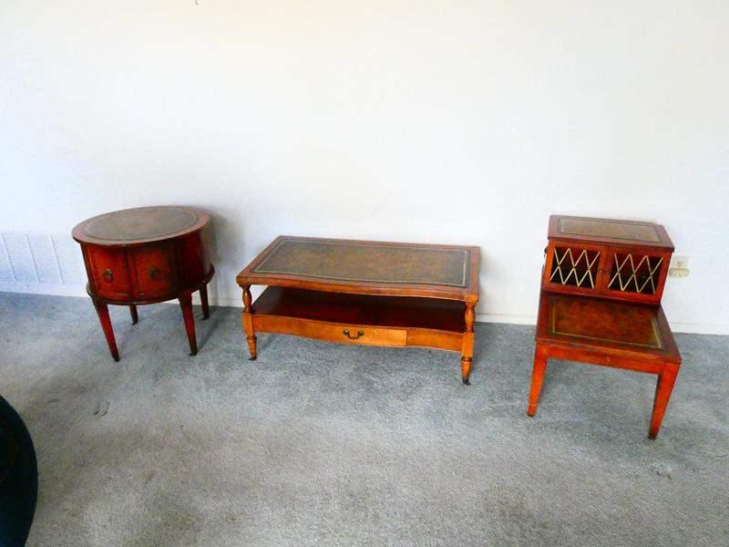 Lot # 75- Three Unique Vintage Leather top tables (main image)