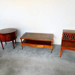 Lot # 75- Three Unique Vintage Leather top tables
