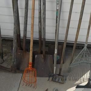 Lot # 227- Jumbo tool lot! Rakes, shovels, pick axes, and more