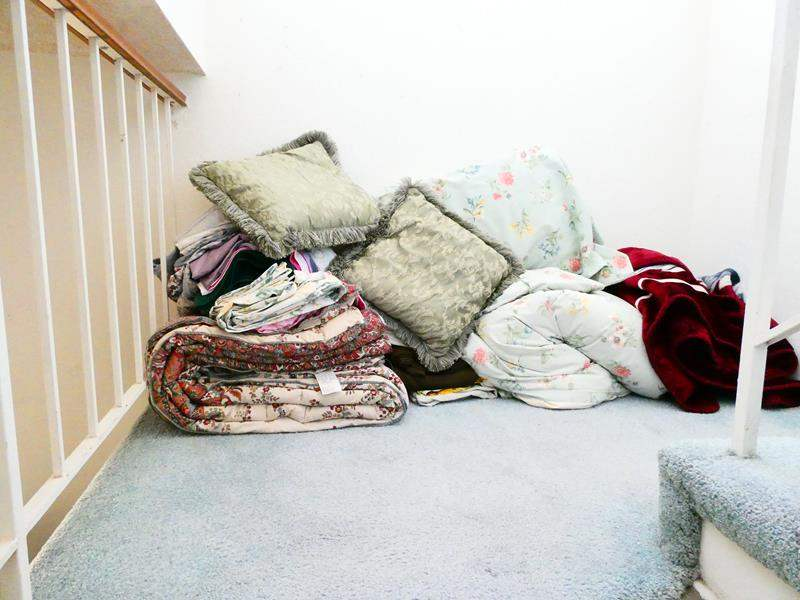 Lot # 77-  Pillows, comforters, blankets and sheet sets (main image)