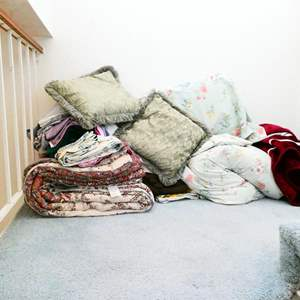 Lot # 77-  Pillows, comforters, blankets and sheet sets